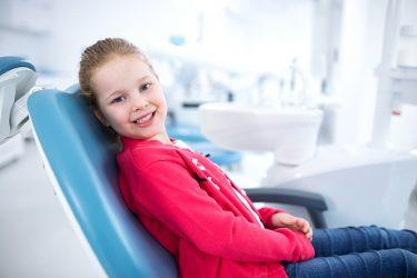 Beautiful smiling little girl - Riley Dental Group in dental office